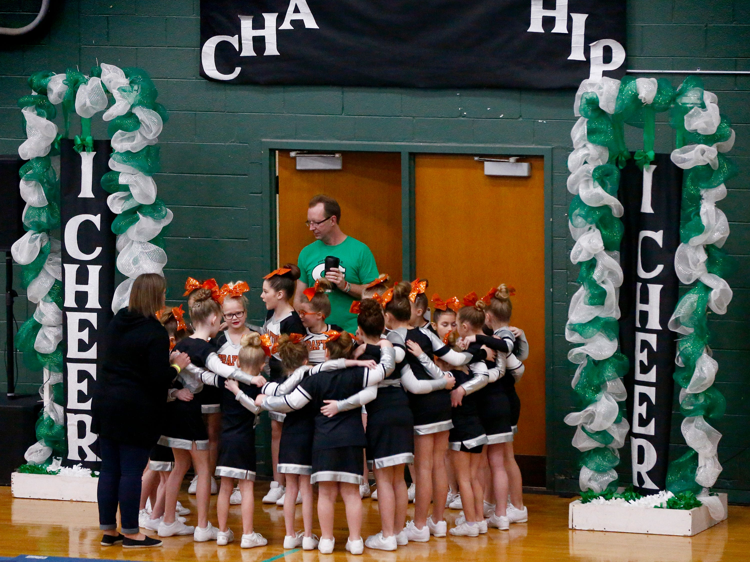 The Grafton Youth team huddles up before taking the mat to compete in the Elementary D1 division during the iCheer Competition at Greendale High School on Jan. 26.