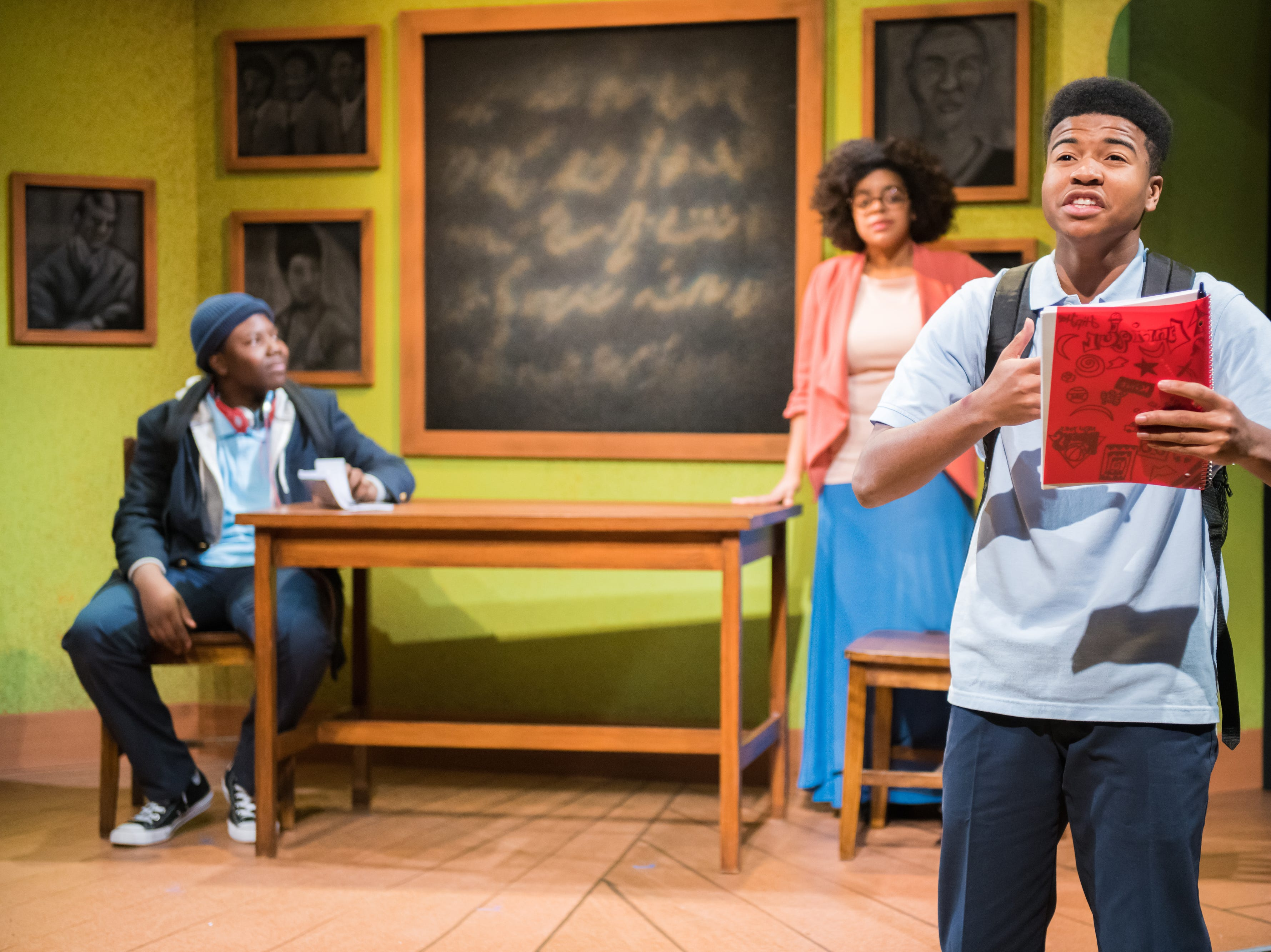 """Nahjee Robinson (front) and Jakobie Jackson and Nadja Simmonds perform in First Stage's production of """"Locomotion"""" by Jacqueline Woodson, which continues through Feb. 24 at the Milwaukee Youth Arts Center, 325 W. Walnut St."""
