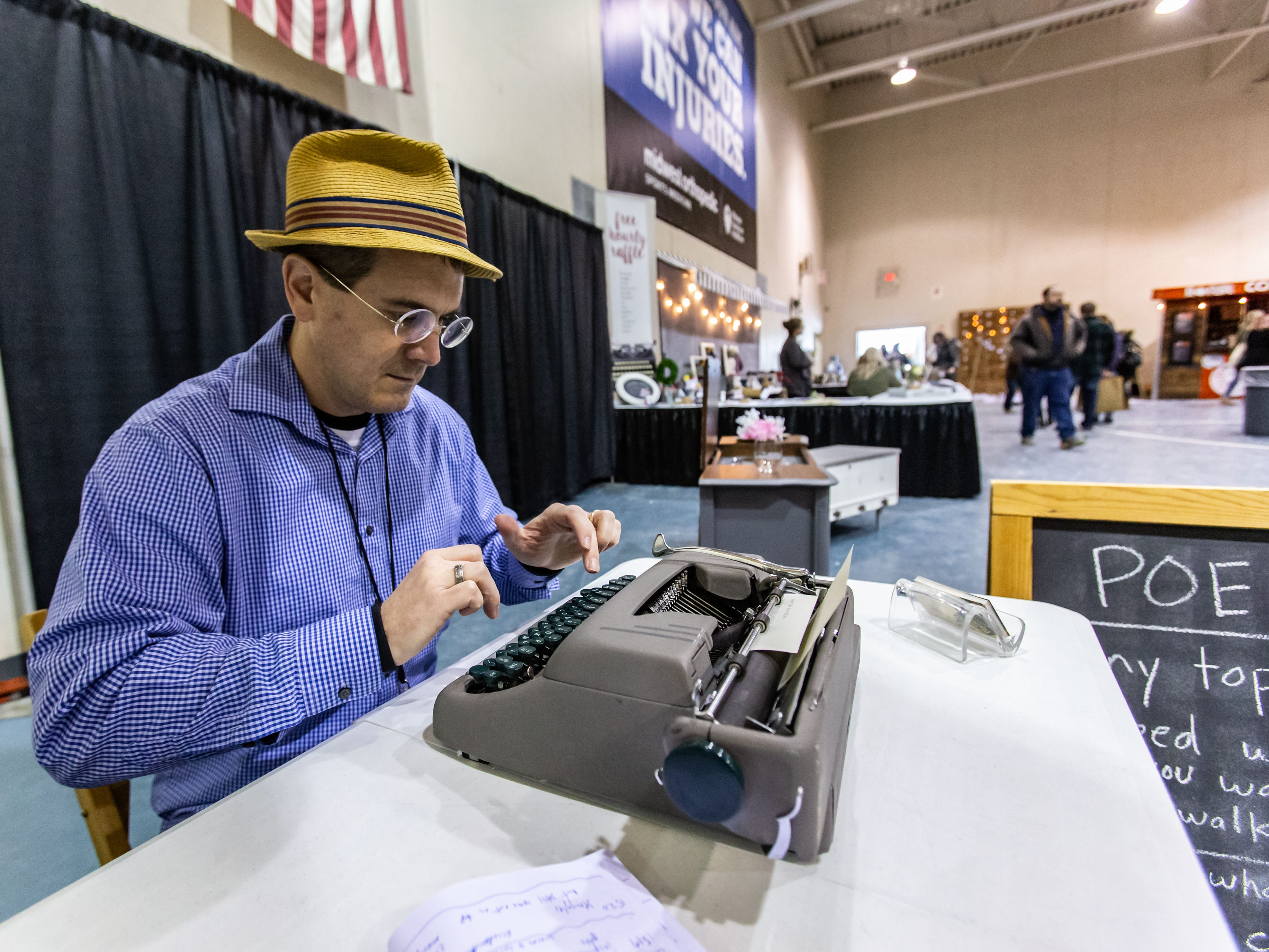Paul Wiegel of the Fox River Poetry Co. in Berlin serves up personalized poems during the re:Craft and Relic show at the Milwaukee County Sports Complex in Franklin on Sunday, Jan. 27, 2019. The show offers vintage, upcycled, antique, handcrafted, reclaimed, and locally-sourced goods.
