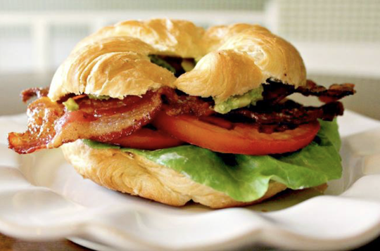 The BLT on a croissant is among the most popular food options at Milwaukee Street Traders.