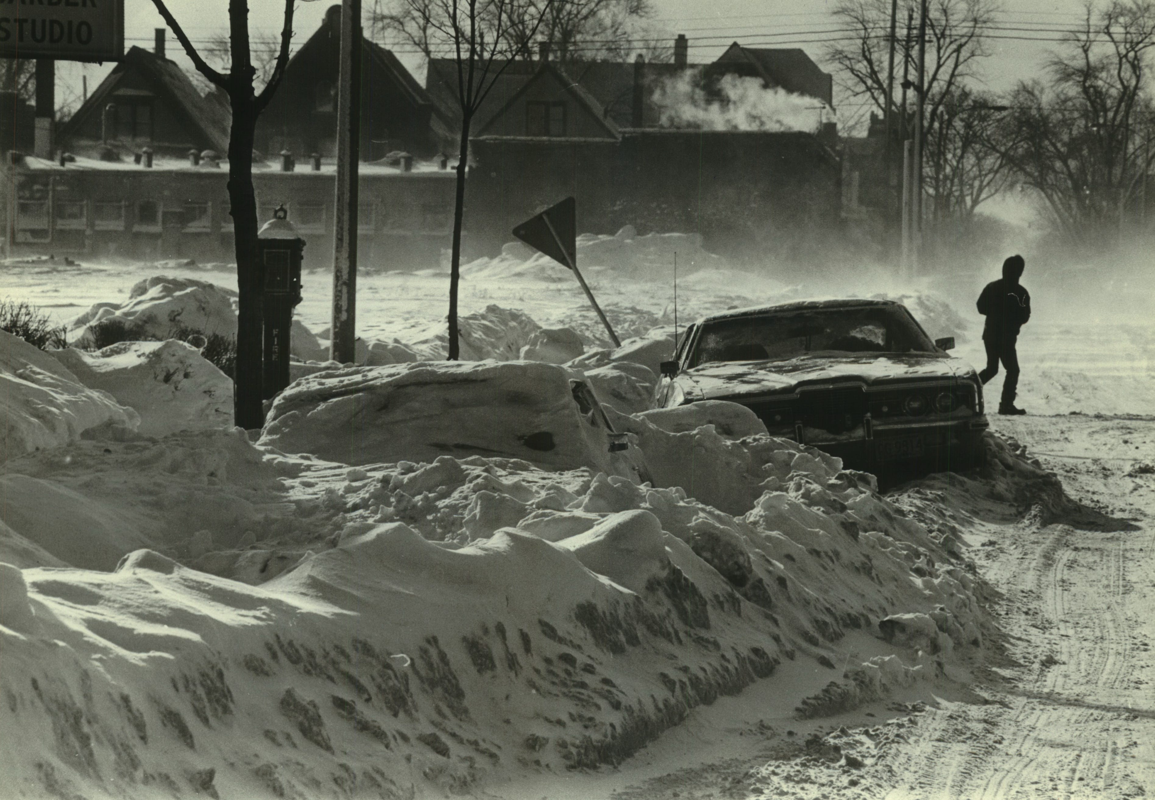 This car, buried almost to the windshield wiper, was one of the abandoned autos that helped clog the 2400 block of North 34th Street on Jan. 16, 1982. (The car was dug out and removed later that day.) Temperaturs dropped to 22 below zero on Jan. 16, 1982; the next day, Milwaukee set a record with 26 below. This photo was on the front page of the Jan. 17, 1982, Milwaukee Journal.