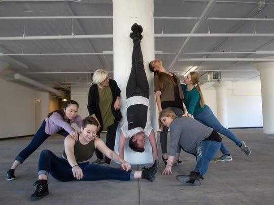 "Elizabeth Roskopf (left), Jimmi Weyneth, artistic director Debra Loewen, Ben Follensbee, Danielle Lohuis, Amanda Laabs, Caitlyn Grubich limber up for WIld Space Dance's ""Making/Unmaking"" performances."