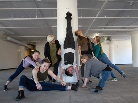 "Elizabeth Roskopf (left), Jimmi Weyneth, artistic director Debra Loewen, Ben Follensbee, Danielle Lohuis, Amanda Laabs, Caitlyn Grubich limber up for WIld Space Dance's ""Making/Unmaking"" performances."