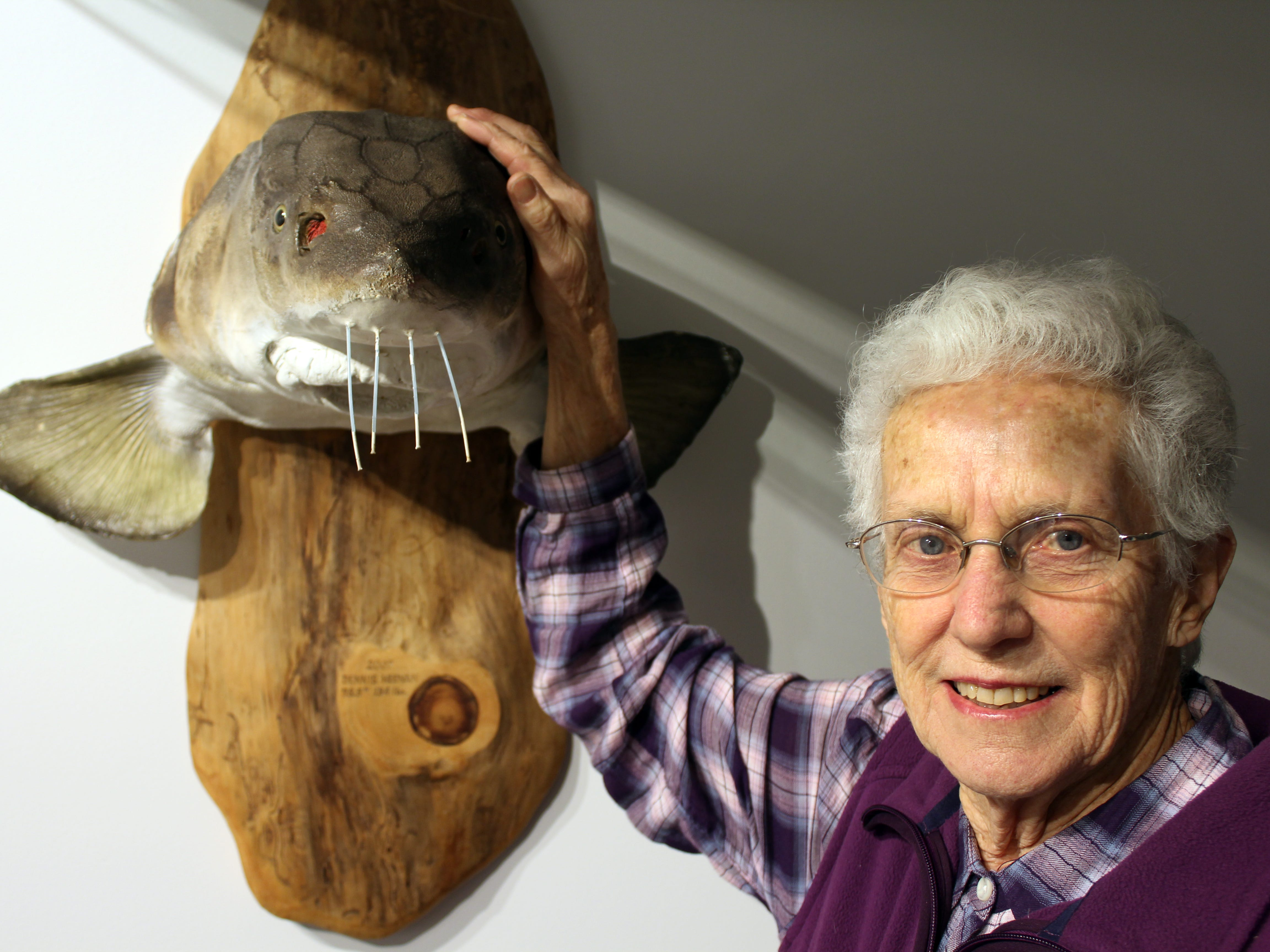 Mary Lou Schneider has speared about two dozen sturgeon, her first as a teenager.