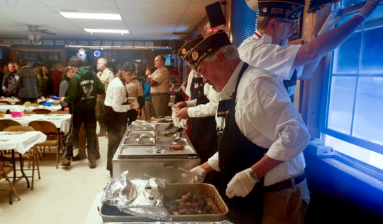 With raccoon meat and all the fixings in place, Post members ready to begin serving to people filling the bar and lined up outside for 93rd annual Delafield American Legion Coon Feed on Jan. 26. The meal includes raccoon meat or turkey, potatoes, stuffing, sauerkraut, relishes and dessert.