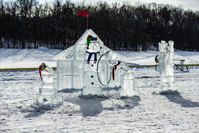 Ice sculptures glisten in the afternoon sun at Lowell Park in Waukesha during the 34th annual Waukesha JanBoree on Sunday, Jan. 27, 2019.