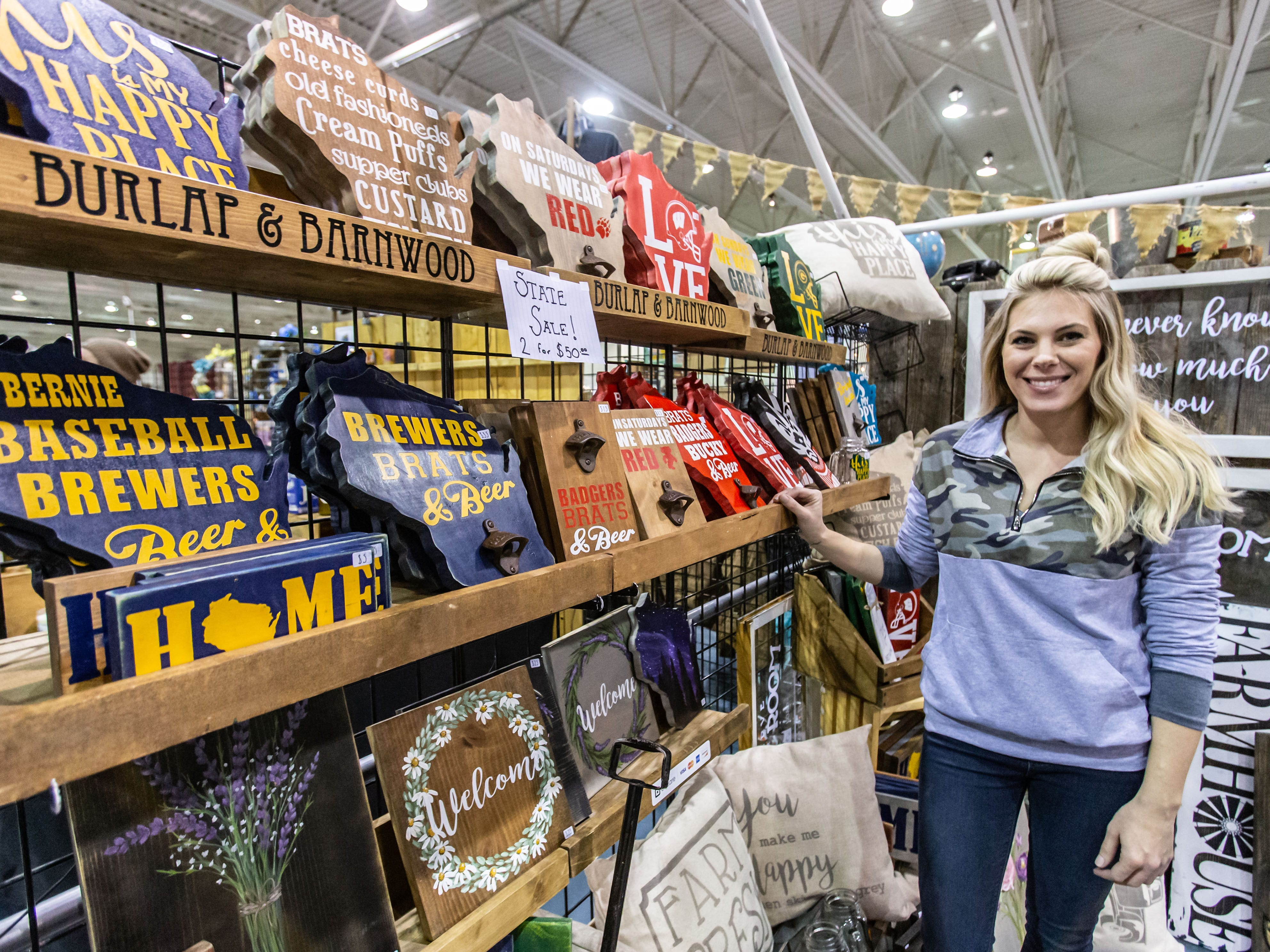 Amanda Massman of Burlap & Barnwood in Oconomowoc offers unique handmade home decor during the re:Craft and Relic show at the Milwaukee County Sports Complex in Franklin on Sunday, Jan. 27, 2019. The show offers vintage, upcycled, antique, handcrafted, reclaimed, and locally-sourced goods.