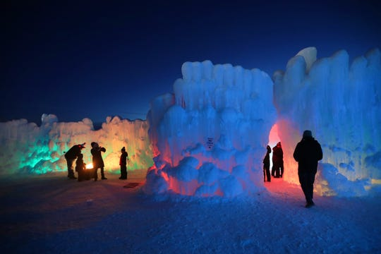 LED lights illuminate the ice formations at the Ice Castles display in Lake Geneva. The Ice Castles, which opened up last week in Lake Geneva, are among six cities across North America where a Utah-based company has built ice castles after growing 5,000 to 12,000 icicles harvested by hand and individually sculpted into ice formations. Newly placed icicles are then drenched with water. Each castle is around one acre in size and takes around two months to construct by 20 to 40 ice artisans.