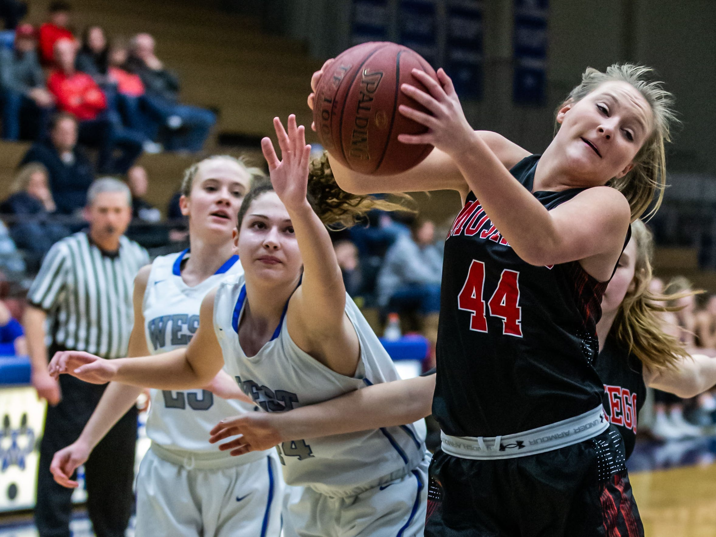 Muskego's Alison Mims (44) pulls down a rebound during the game at Waukesha West on Friday, Jan. 25, 2019.