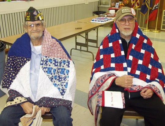 Larry Barker (left) and Dr. Thomas Yoder, both of Cotter, have been lifelong friends and share the brotherhood of also being Veterans that served in Vietnam. The pair were recently recognized by theMountain Home Quilts of Valor in aceremony at the Cotter VFW, with friends and family attending.Barker served in the U.S. Army from1967-1989, including three tours in Vietnam. Barkerreceived multiple wounds and injuries.Yoder served 13 years in the Air Force, followed by sevenyears in the U.S. Army. He also servedin Vietnam, suffering wounds and injuries.