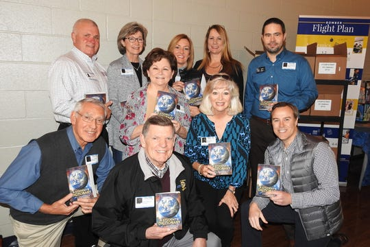 Mountain Home Rotarians recently completed deliver of more than 400 dictionaries tothird-graders at area schools. Rotarians pictured are: (first row, from left)Glen Dimick, Larry Nelson, Brenda Nelson, Jay Chafin, (second row)Steve Litty, Renae Schocke, Nita Davis, Susan Stockton, Dauna Tysonand project coordinator Scott Copeland.