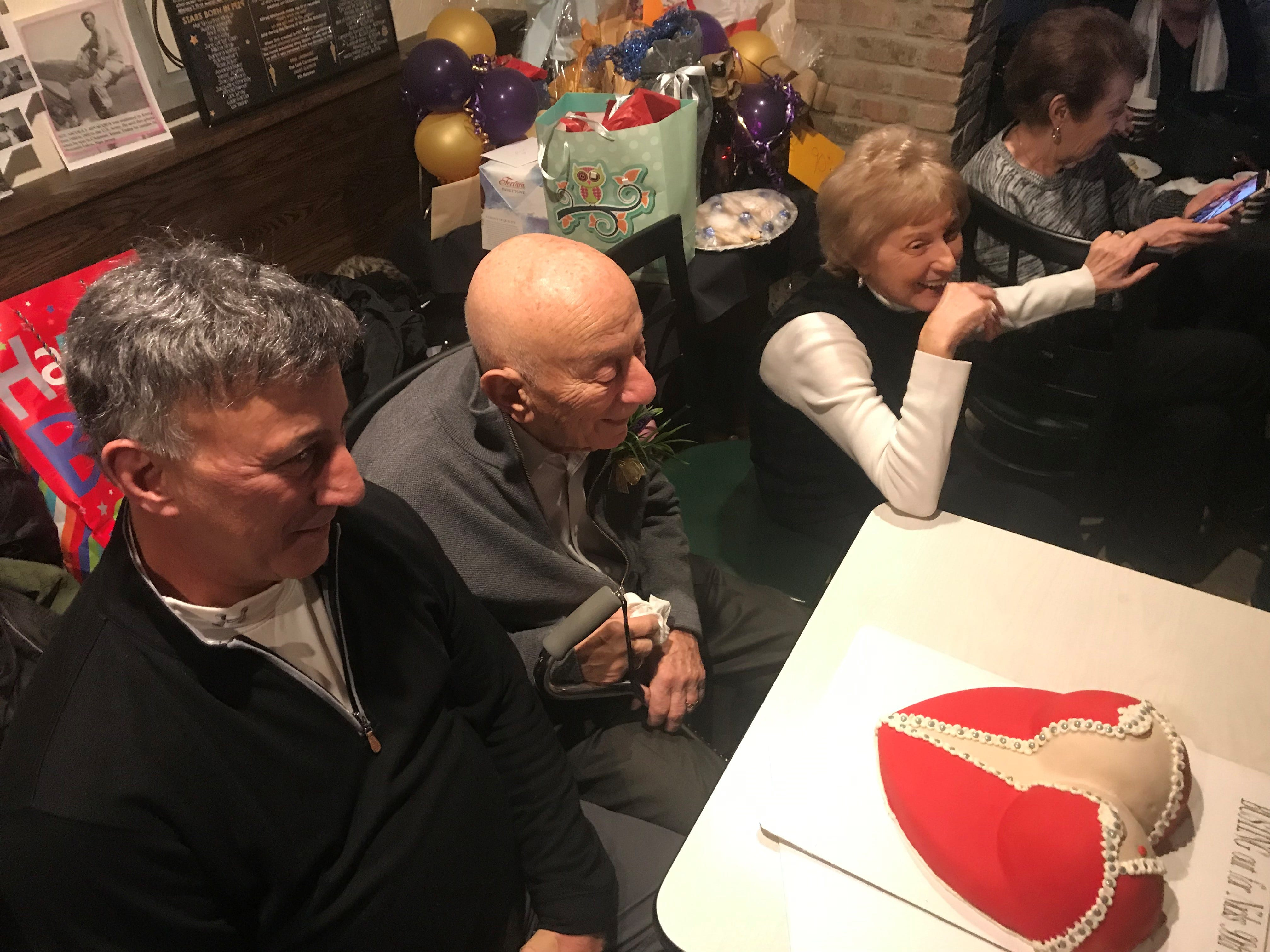 "Nicola ""Nick"" Bevacqua Jr., patriarch of the Bevacqua family that has owned and operated the Reservoir Tavern in Parsippany since 1936, receives a naughty cake. The famous Italian restaurant - the 10th oldest pizzeria in the United States - opened on a rare Sunday to celebrate Nick Jr.'s 90th birthday. Gannon has been a customer since he was a child. January 27, 2019."