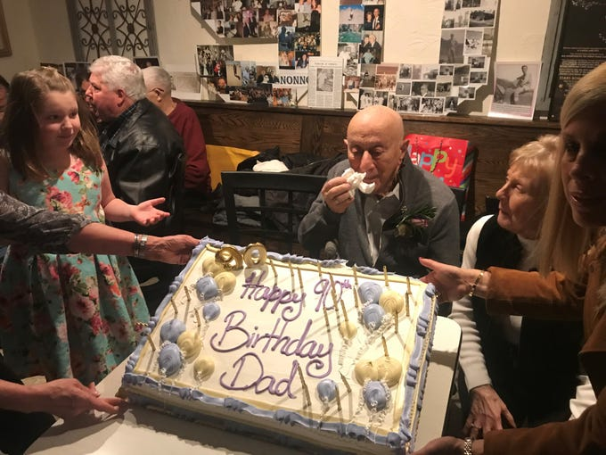 """Nicola """"Nick"""" Bevacqua Jr., patriarch of the Bevacqua family that has owned and operated the Reservoir Tavern in Parsippany since 1936, receives a cake for his 90th birthday. The famous Italian restaurant - the 10th oldest pizzeria in the United States - opened on a rare Sunday to celebrate Nick Jr.'s 90th birthday. Gannon has been a customer since he was a child. January 27, 2019."""