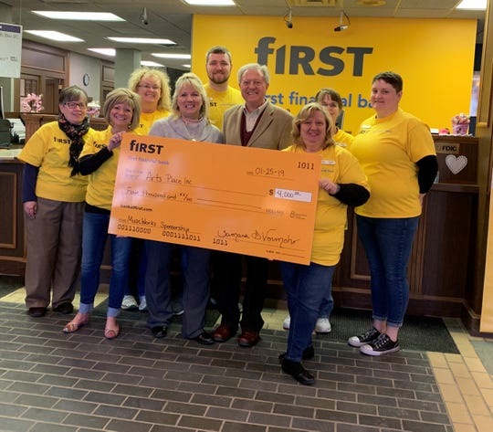 First Financial Bank presents $4,000 to Arts Place for scholarships. Pictured are (from left): Sally Conwell, Tami Vormohr, Kristy Inman, Carolyn Carducci, Dylan Franks, Eric Rogers, Tressie Monroe, Karen White, and Amanda Haskett.