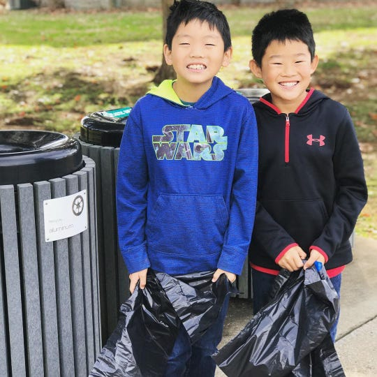 Bates Brown, 10, and Brodie Brown, 8, did some cleanup Saturday after the Stones River National Battlefield reopened amid the reprieve of the government shutdown. The boys earned a Junior Ranger badge.