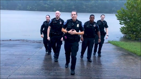 Smyrna Police Department Officer Laura Enright leads fellow employees in a lip-sync video of Rachel Platten's 'Fight Song' in support of those battling cancer.