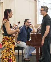 """Grammy-winning musician Rhiannon Giddens, left, and Italian pianist and percussionist Francesco Turrisi, center, work with Paul Vasterling, the Nashville Ballet's artistic director. Giddens and Turrisi have composed an original score for """"Lucy Negro Redux,"""" which they will perform live in February."""