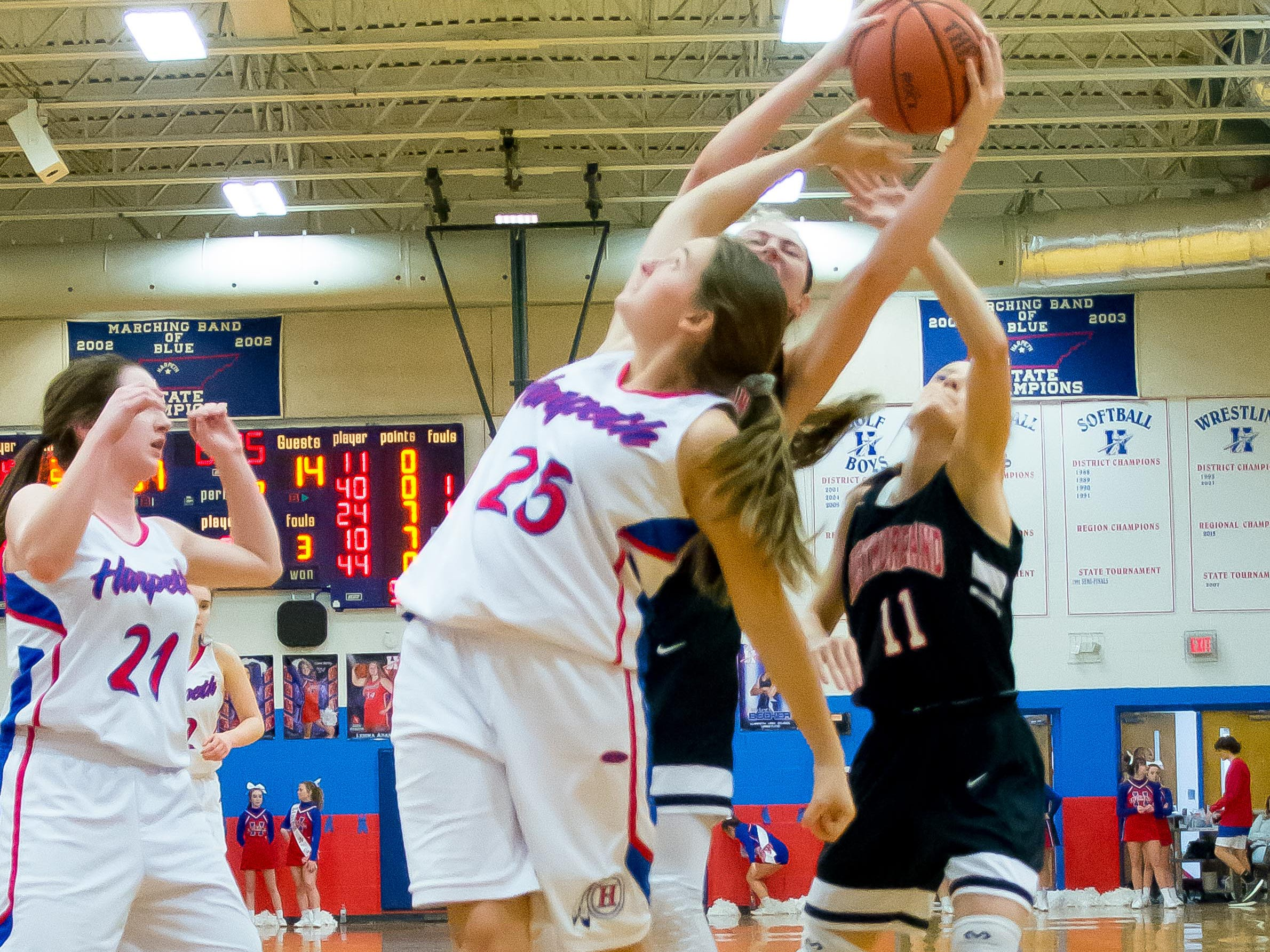 #25 Evie Bledsoe reaching for the rebound for Harpeth.