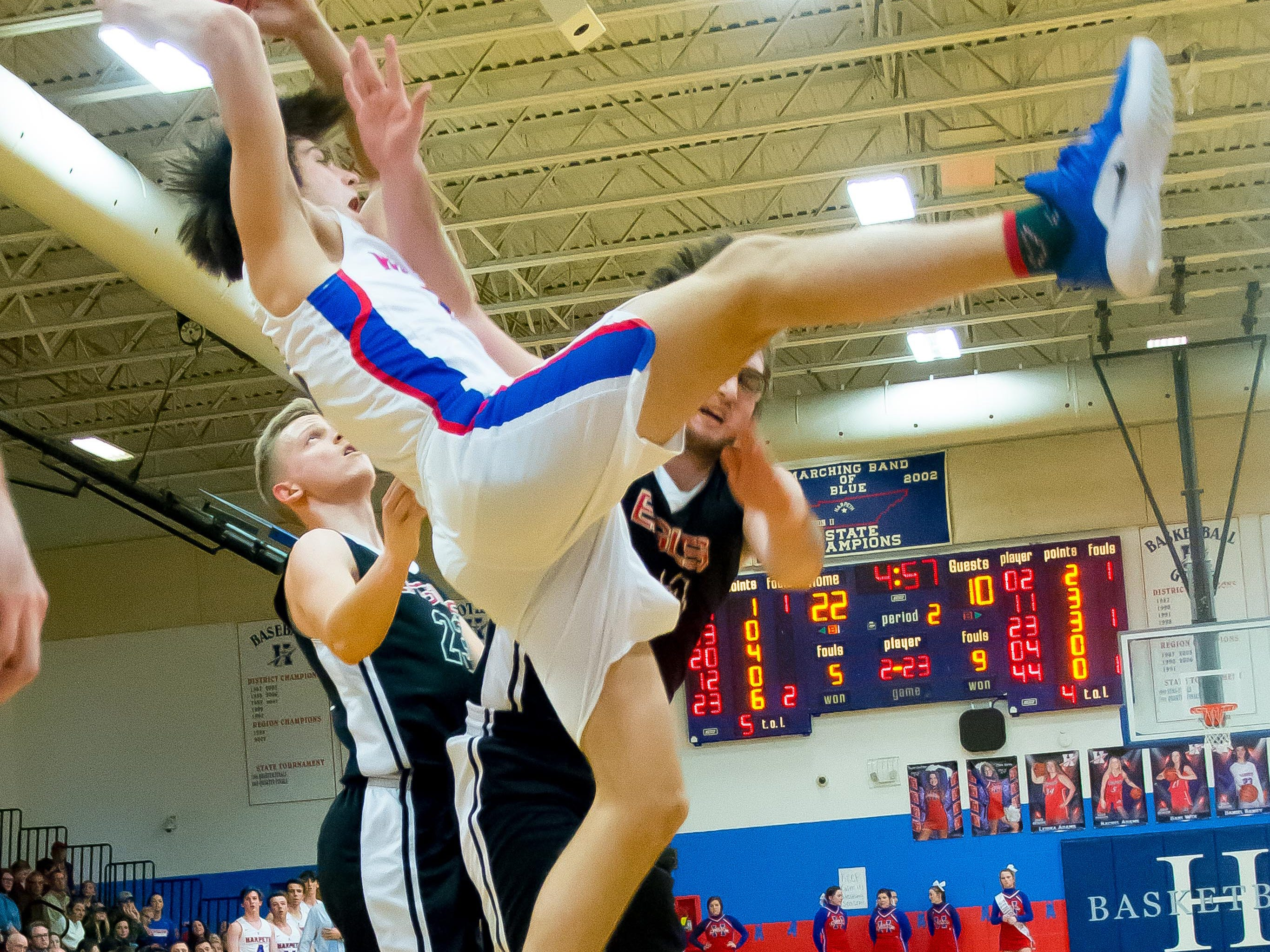 Harpeths Grayson Maddox comeing down with the rebound.