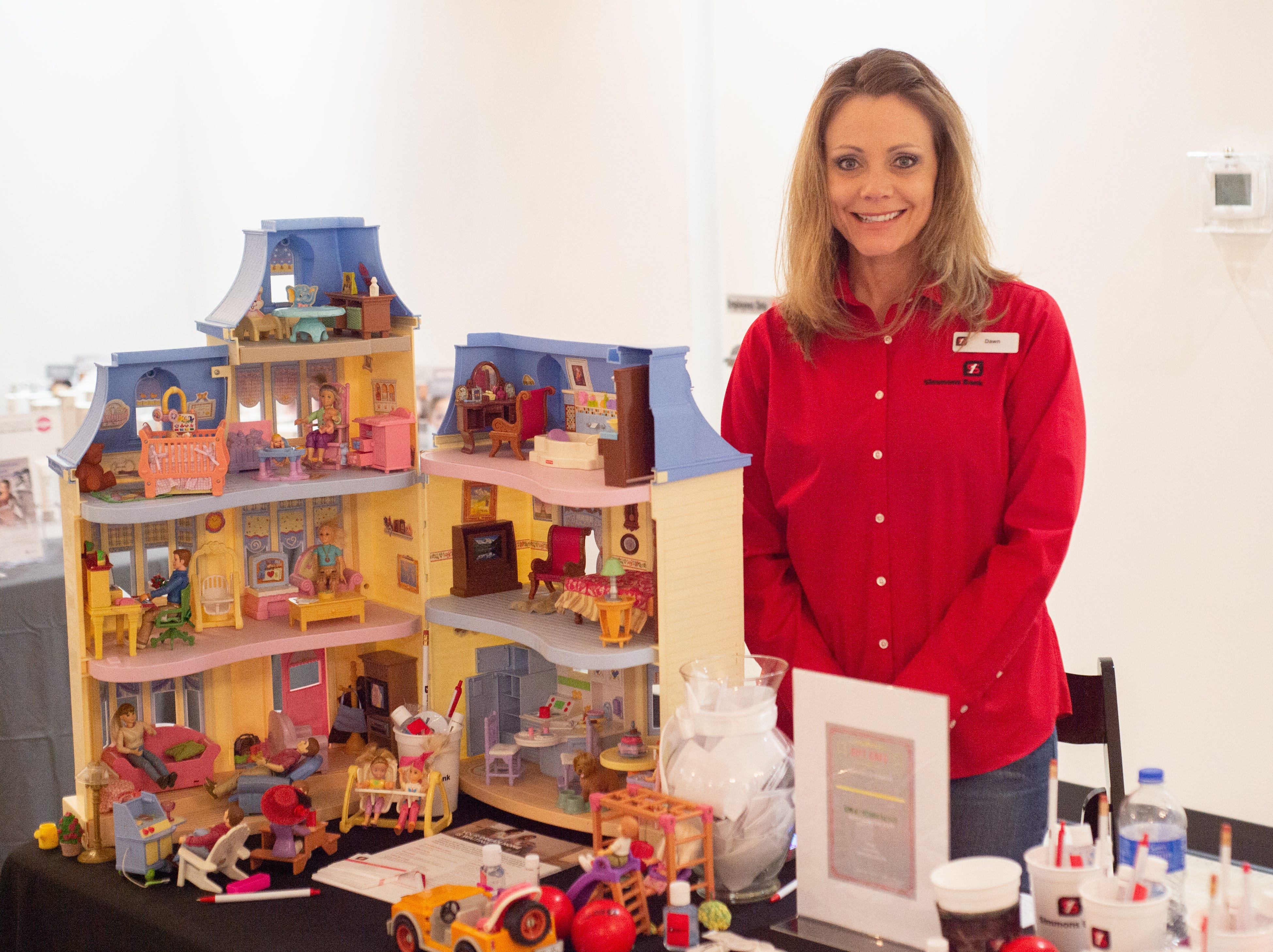 Dawn Harrison helps out with the Sumner County Bridal Show at Epic Event Center in Gallatin on Sunday, Jan. 27. The event was presented by the Gallatin Chamber of Commerce and Epic Event Center.
