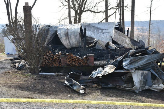 The burned home on Wrigley Road in Hickman County where a 6-year-old died during the Monday morning fire, according to state and local authorities.
