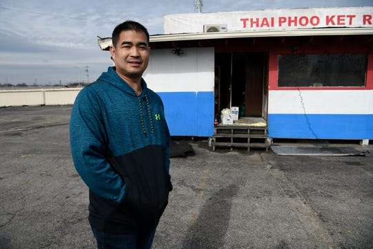 Thai Phooket owner Bee Dipasuth stands outside his restaurant Monday Jan. 28, 2019 in Nashville, Tenn. after a kitchen fire damaged his establishment Sunday night. Dipasuth plans to rebuild.