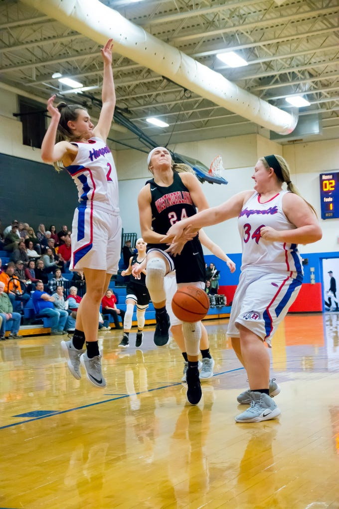 Harpeth Senior #34 Leigha Adams with the block on Westmorelands Paige Akins.