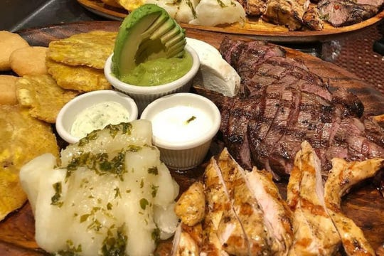 Parrilla El Meson is a Venezuelan combination plate of chicken, carne asada and grilled ribs served with tostones, yuca and salad at El Meson Latin Cuisine Bar & Grill in Bonita Springs.