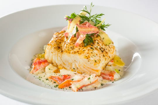 Ocean Prime's Valentine's Day menu features roasted sea bass over Alaskan king crab gnocchi with champagne cream.