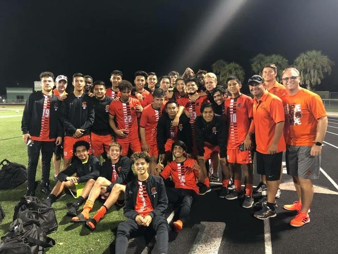 The Lely boys soccer team gathers after Senior Night festivities last week. The Trojans enter the Class 3A-District 14 playoffs on a row, winning 12 in a row and going unbeaten over their last 19 games.