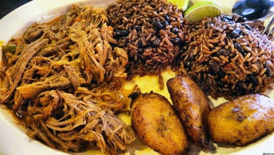 Cuban roasted pork served with congri and plantains at El Meson Latin Cuisine Bar & Grill in Bonita Springs.
