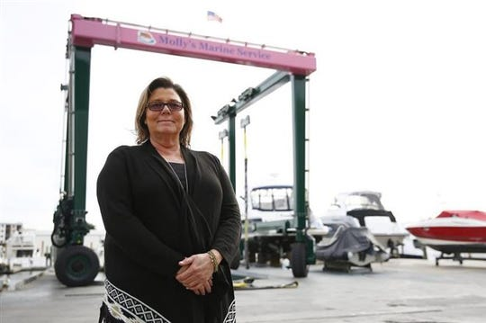 Owner Molly Strassel is shown in this file photo at Molly's Marine Service in downtown Naples, Fla. Strassel has been at the helm of her business for the past 11 years after taking over the location from Allied Marine, where she was director of operations for 15 years.