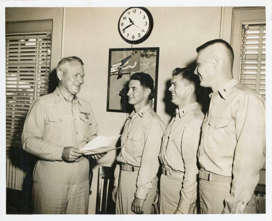 George Vega, second from left, with fellow Marines.