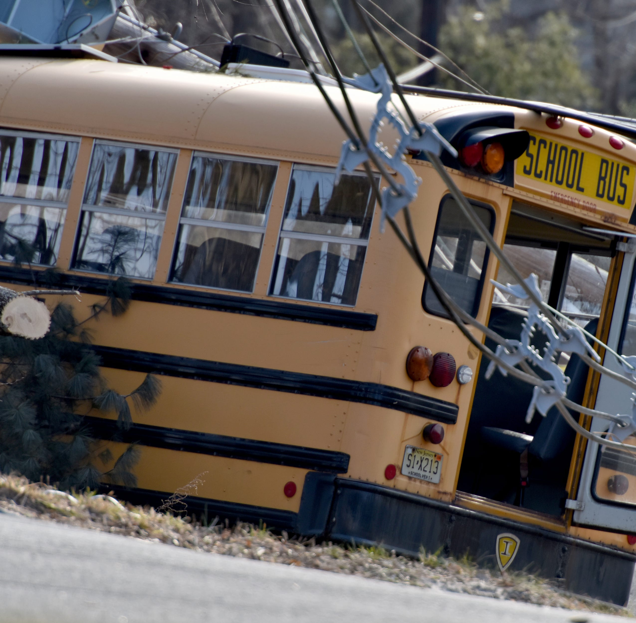 8 children safely removed from bus trapped under power lines after crash in Long Hill