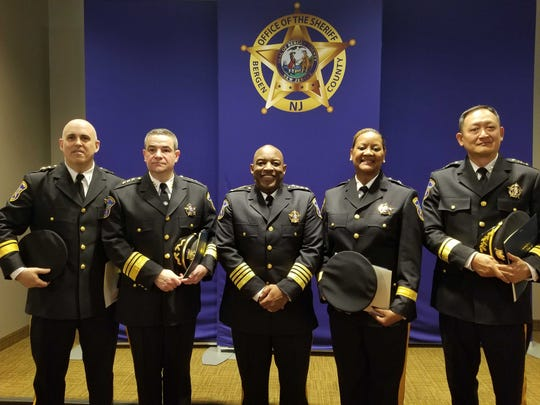Sheriff Anthony Cureton's command staff, as sworn-in Monday. From left to right: Undersheriff Dave Borzotta, Executive Undersheriff Vincent Quatrone, Sheriff Anthony Cureton, Chief Warrant Officer Cora Taylor, and Undersheriff Jin Sung Kim.