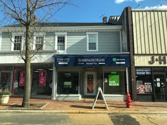 """Consuelo's Travel in Freehold Borough covered up mentions of """"immigration services"""" after the state charged the local chain with immigration services fraud in November."""