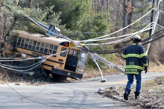 A school bus with eight students on board crashed into the intersection of Long Hill and Meyersville roads in Long Hill on Monday, January 28, 2019. Utility poles were taken down and live wires were resting on the bus after the crash. The students were not injured.