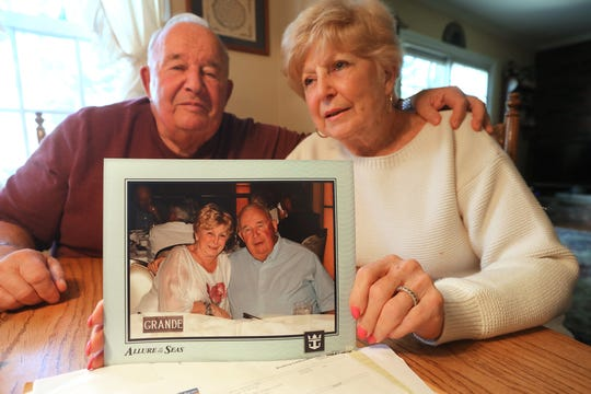 "Bertram ""Buzz"" and Carol Palk of Whipanny talk about their difficult experiences after they were removed from a cruise ship in Mexico due to a problem with Carol's health. They are at their kitchen table on January 25, 2019 with a photo that was taken on the cruise ship before they were let go in Mexico."