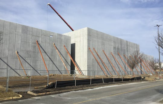 The massive concrete shell of the movie theater was buttressed by steel beams on Jan. 28.