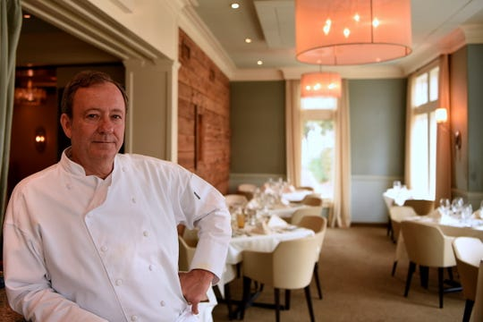 Cafe Panache's Kevin Kohler in one of his two charming dining rooms.
