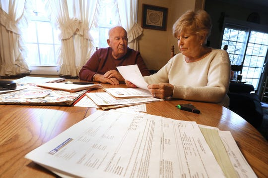 """Bertram """"Buzz"""" and Carol Palk of Whipanny talk about their difficult experiences after they were removed from a cruise ship in Mexico due to a problem with Carol's health. They are at their kitchen table on January 25, 2019 with papers and bills accrued on their trip."""
