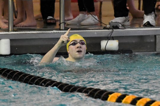 Indian Hills' Brian Coughlin points to the scoreboard after winning the 200-yard individual medley during the Bergen County Meet of Champions on Sunday, Jan. 27, 2019, in West Nyack.