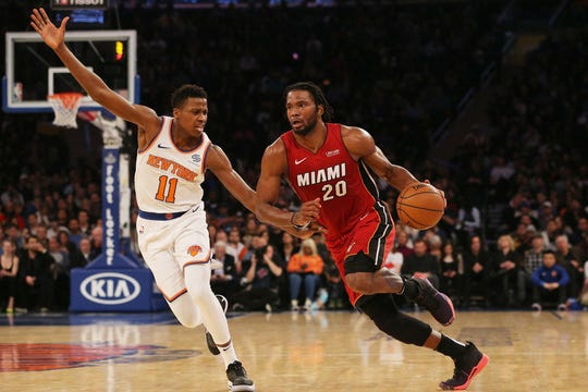 Miami Heat forward Justise Winslow (20) drives to the basket against New York Knicks guard Frank Ntilikina (11) during the first quarter at Madison Square Garden.