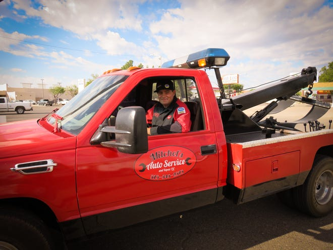 Mitchel Boomgaarn, who owns Mitchel's Auto Service and Repair, LLC in Deming, smiles from the cab of his tow truck. Boomgaarn was named the 2018 Star Client of the Small Business Development Center hosted by Western New Mexico University.
