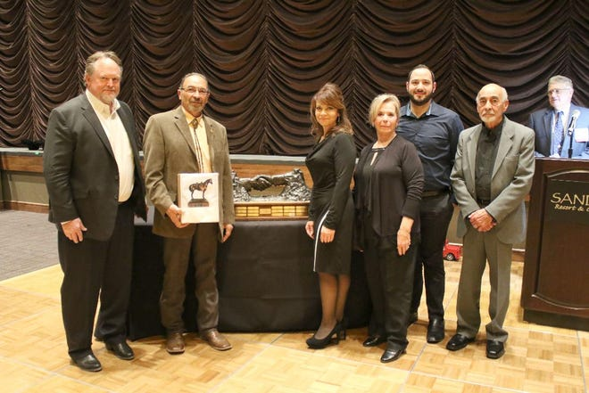 Pictured, from left, are Alan Feit, Farm Credit of New Mexico CEO, also representing CO Bank; Jose Varela Lopez, his sister Michelle Romero, mother Lori, nephew Nick Romero, father Joseph; and Joe Bill Nunn, 2018 Cattleman of the Year who made the presentation.