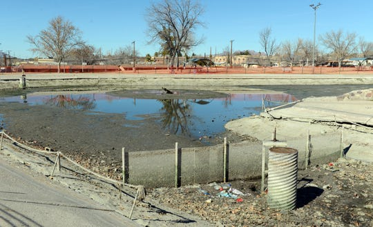 The pond at Young Park on Monday, Jan. 28. It has been drained so that it can be cleaned and repaired.