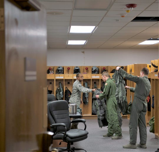 Senior Airman Dondrel Pedescleaux, 54th Operations Support Squadron aircrew flight equipment technician, preps Airmen for familiarization flights, Dec. 18, 2018, on Holloman Air Force Base, N.M. This is the final check before they take flight.