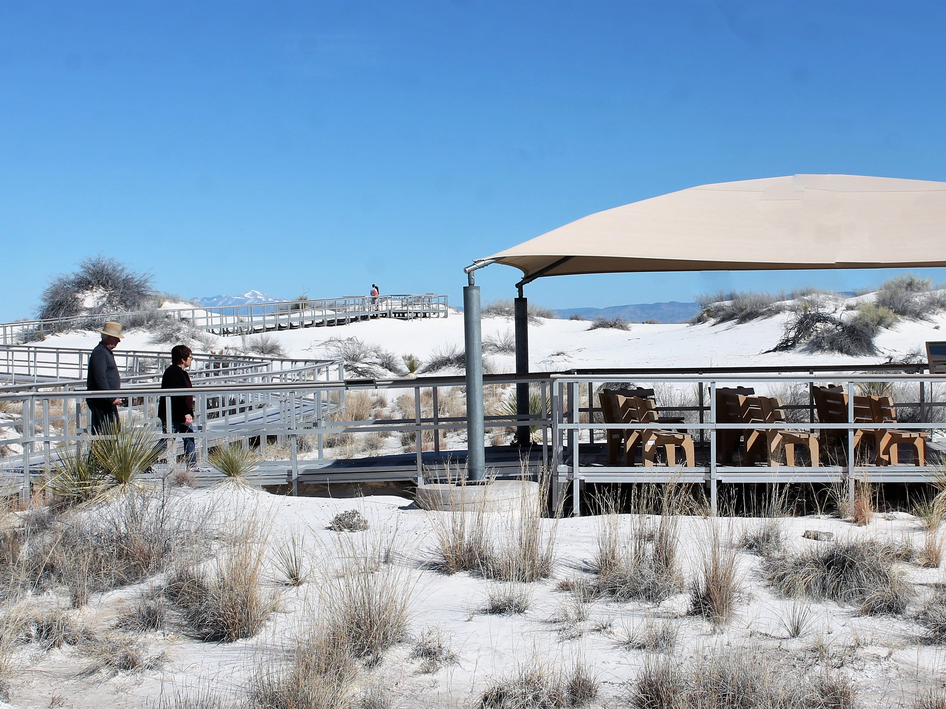 White Sands National Monument visitors explore the Interdune Boardwalk Monday morning.