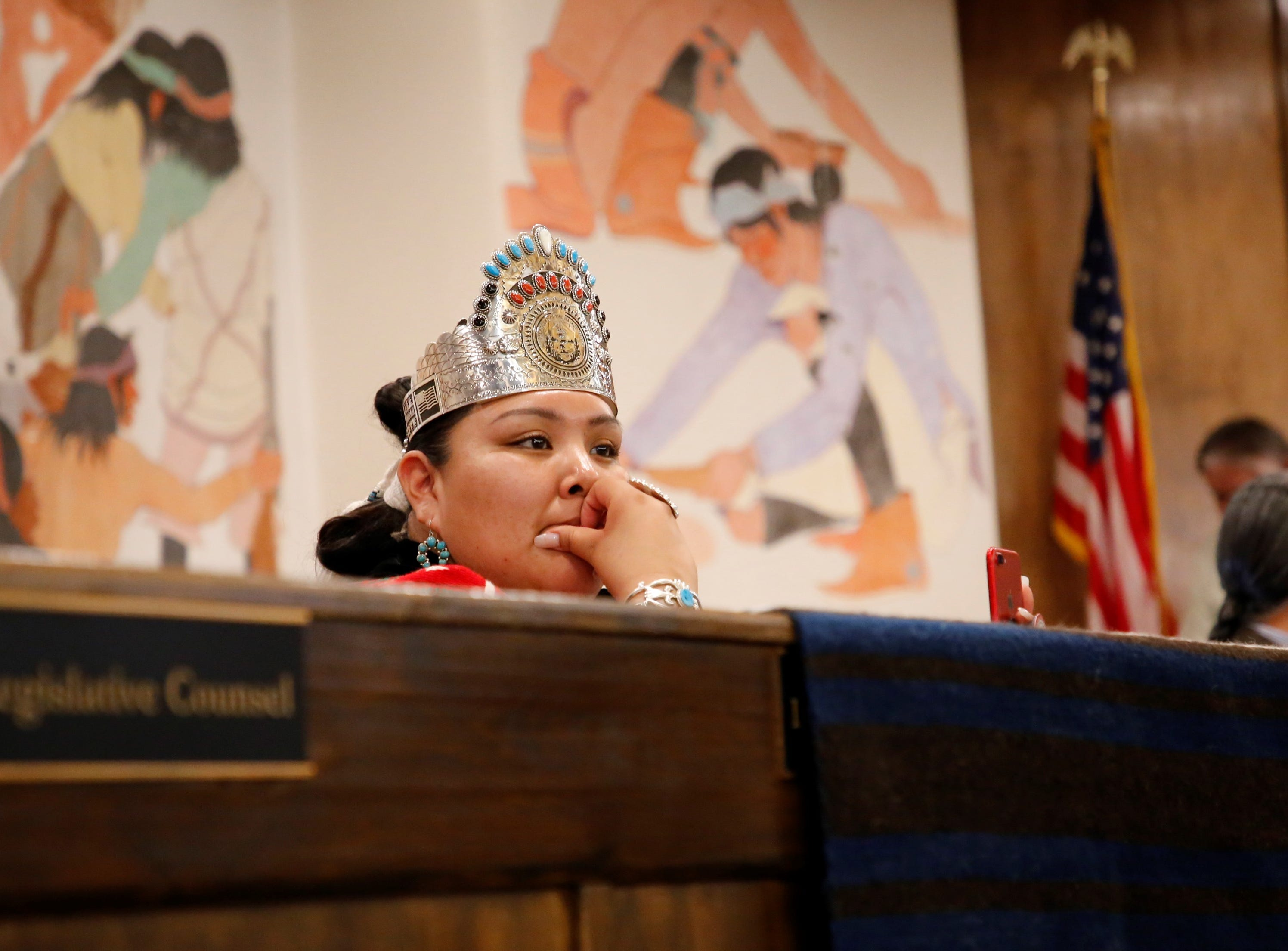 Miss Navajo Nation Autumn Montoya uses her phone to record a portion of the Navajo Nation Council's winter session on Monday in Window Rock, Ariz.