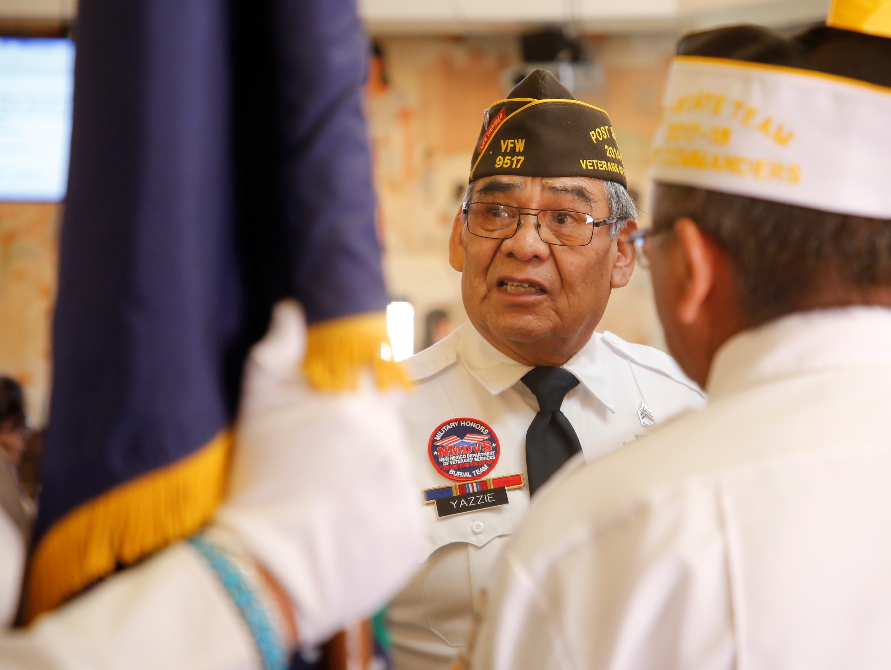 Shiprock Veterans of Foreign Wars Post 9517 Trustee Tommie Yazzie provides instructions to members before the start of the Navajo Nation Council's winter session on Monday in Window Rock, Ariz.